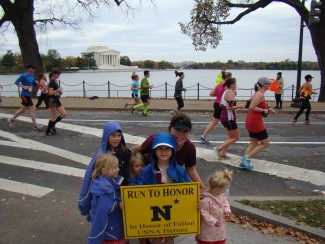 Stopping to smooch my cuties during the Marine Corps Marathon in October 2012 (first Marathon!)