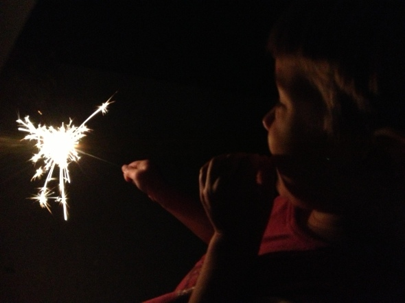 Claire being brave with her sparkler