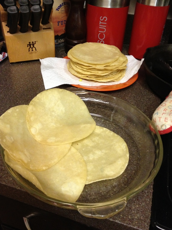 "building the ""crust"" with the tortillas"