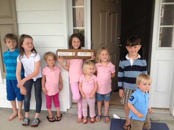 "That sign says ""Platform 9 3/4"" - Cousins Charlie, Elsie, and Milo with 5/6 of our kiddos"